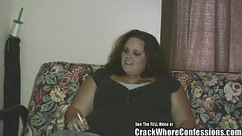 Худощавая девушка в колготочках ласкает фаллоимитатором на полу
